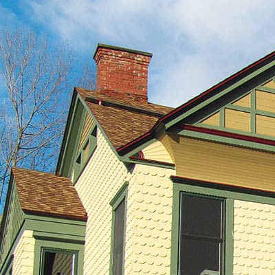 repainted stick style house with curb appeal and refined roofing