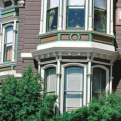 repainted san francisco townhouse with curb appeal and gray, white, green and ochre color scheme