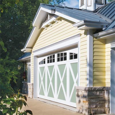 roll up sectional garage door with decorative braces and vertical stiles