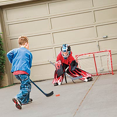 kids playing in front of garage