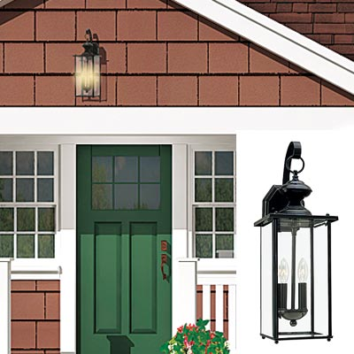 cottage with lantern in exterior entryway