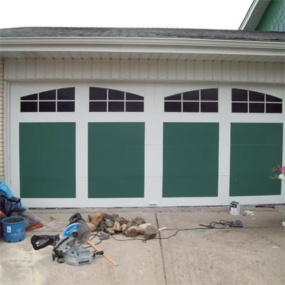 garage doors with carriage doors painted on front for money saving reader remodel