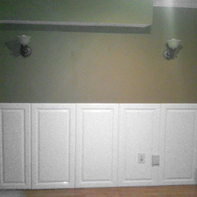 """I created wainscoting out of salvaged cabinet doors"