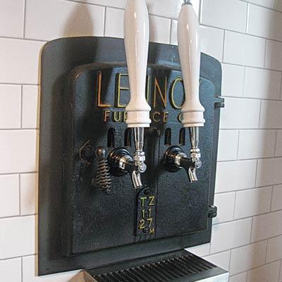 furnace door salvaged into beer tap