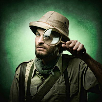 Man holding magnifying glass