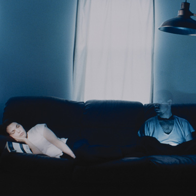 Woman on couch with a ghost