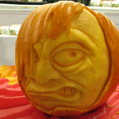 Peeping face carved pumpkin for contest