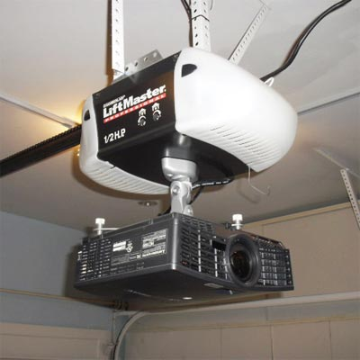projection TV mounted to the bottom of a garage door opener
