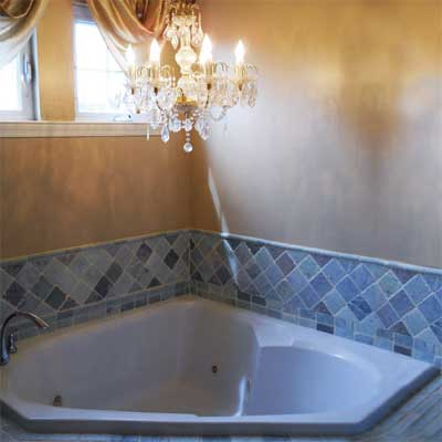 large electrical chandelier hanging directly over whirlpool bath