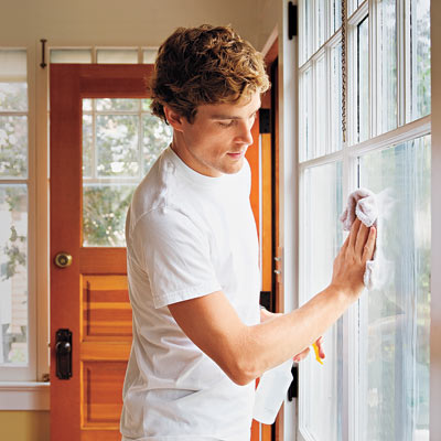Man washing windows for easy upgrade home solution