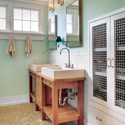 Screened-in bathroom cabinet in green bath