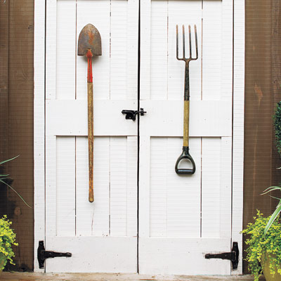 Decorative tools on outdoor shed door