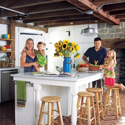 family in remodeled farmhouse kitchen