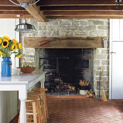 remodeled farmhouse kitchen with stone hearth