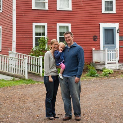 homeowners standing in front of the historic bedford house before this old house remodel