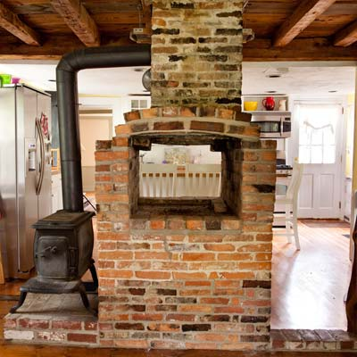wood-burning stove and fireplace of the bedford house before this old house remodel