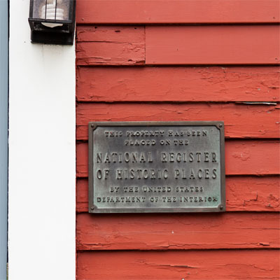 National Register of Historic Places plaque displayed outside the bedford house before this old house remodel
