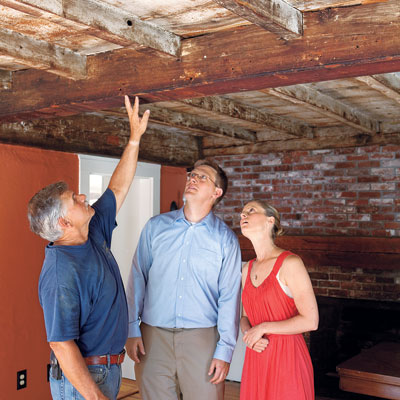 Page family examines the interior of the Bedford Homestead