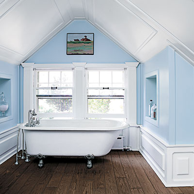 bathroom with blue walls and vaulted ceiling