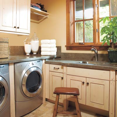 laundry room with open shelves, cabinetry, countertops, sink and tile floor