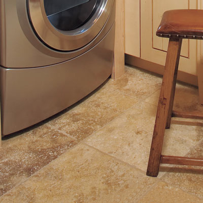 laundry room with water resistant floors and countertops