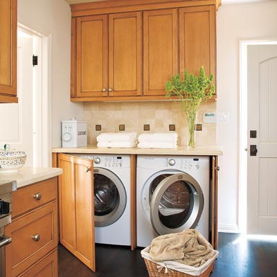laundry room hidden in kitchen sideboard