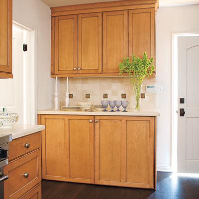 laundry room hidden in kitchen sideboard