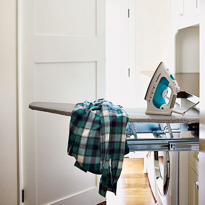 mudroom laundry room with retractable ironing board