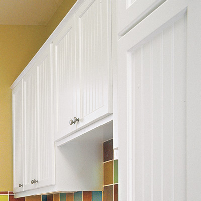 hobby space laundry room with beadboard built in cabinets
