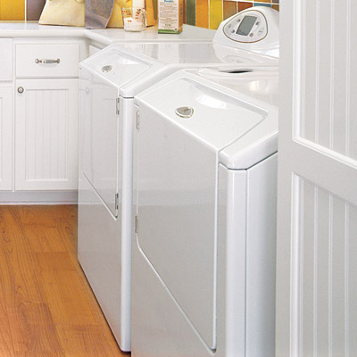 hobby space laundry room with white cabinets and white washer and dryer