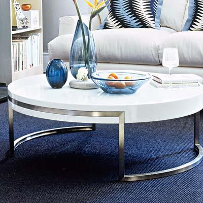 deep and dramatic living room with circular coffee table