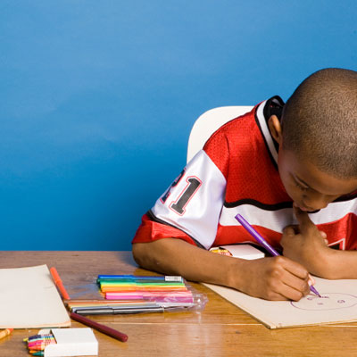 Boy coloring at a desk