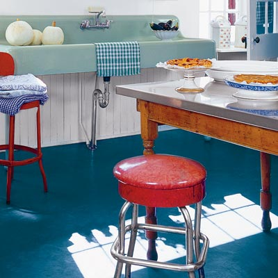 a blue linoleum kitchen floor