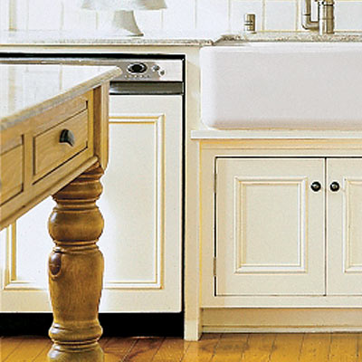 a dishwasher with a cover to match the wood cabinetry