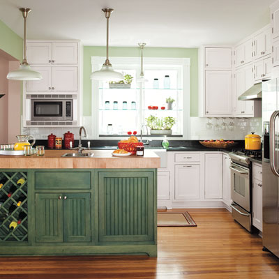 Remodeled open kitchen with green walls and kitchen island