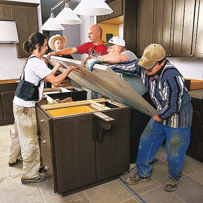workers building a kitchen island