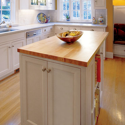 a Crate & Barrel kitchen island designed for storage
