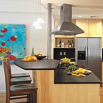 a kitchen island designed for cooking and dining