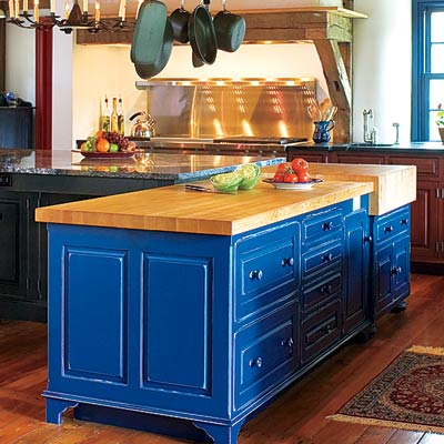 a cobalt blue L-shaped kitchen island