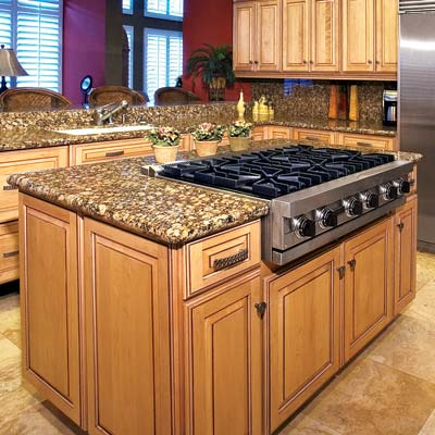 a kitchen island with a cooktop