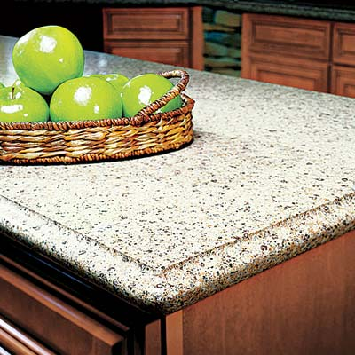 a kitchen island with a stone countertop with green apples