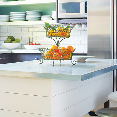a kitchen island with a stainless steel countertop