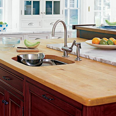 a kitchen island with a butcher block countertop
