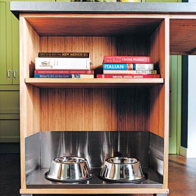 a kitchen island with an alcove for dog bowls