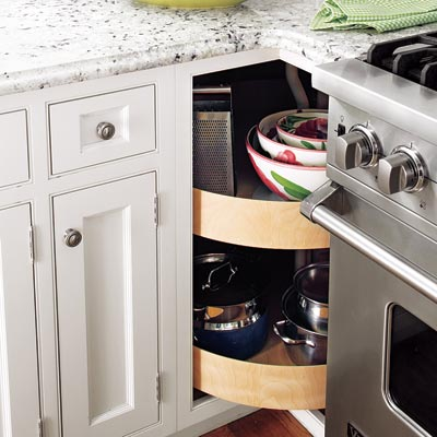 a built-in lazy Susan cabinet in a small kitchen