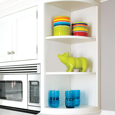 the open shelves in a small kitchen