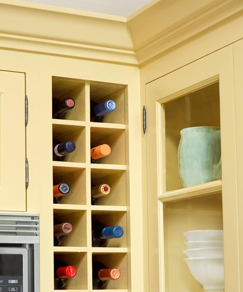 built-in wine cubbies after yellow kitchen remodel