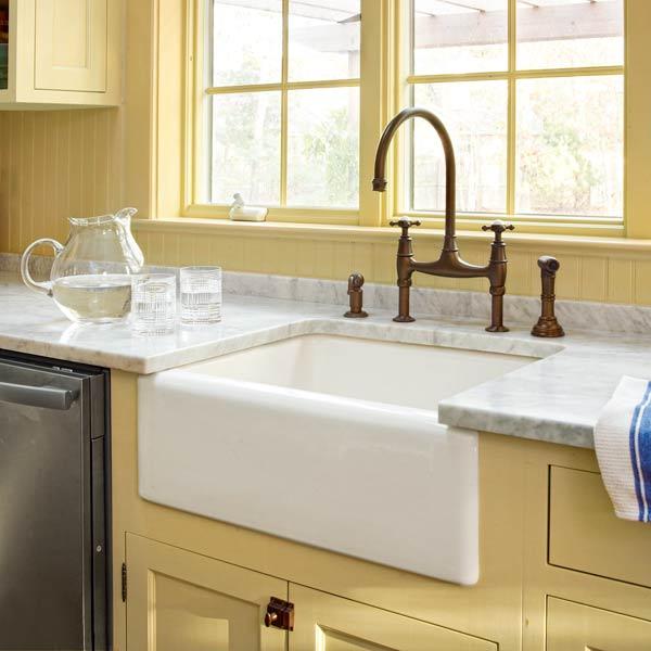apron sink and beadboard backsplash after yellow kitchen remodel