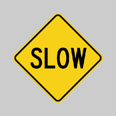 decrease speed road sign
