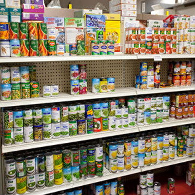 canned foods lining a store shelf; hurricane irene; storm prep